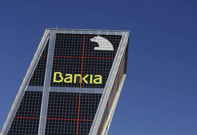 The headquarters of Spain's Bankia bank is seen behind a red traffic light in Madrid