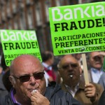 Junior debt holders of Bankia blows whistles during a protest in Madrid