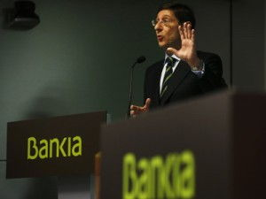 Bankia Chairman Goirigolzarri gestures during a news conference in Madrid